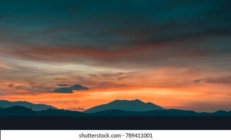 Beautiful sky is sunrise. Colorful cloudy with text. Filters effect teal and orange.