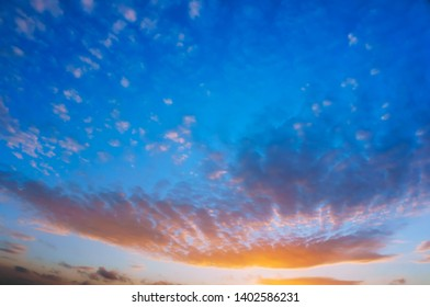 beautiful sky at sunset, blue and pink clouds at sunrise