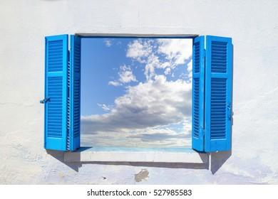 Beautiful sky through blue window
