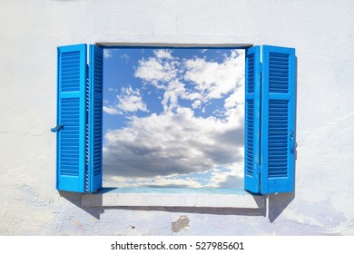 Beautiful sky through blue window