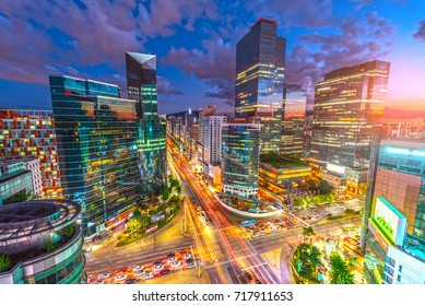 Beautiful sky and Traffic speeds through an intersection at night in Gangnam, Seoul in South Korea.Traffic.
