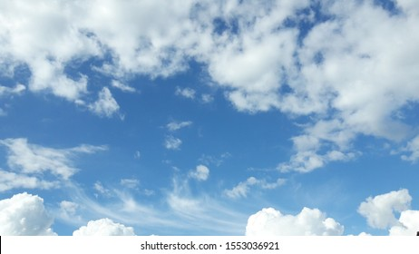 Beautiful sky with white clouds at noon