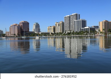 Beautiful skyline of downtown West Palm Beach with reflections in the lake