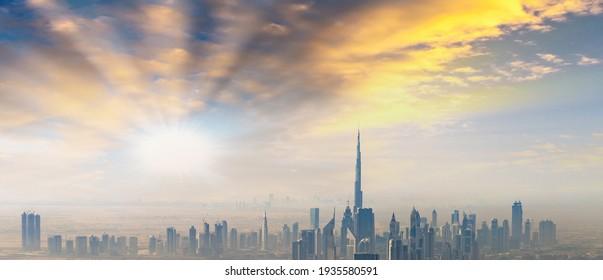 Beautiful skyline of Dubai surrounded by sand dust.