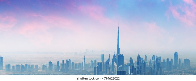 Beautiful skyline of Dubai surrounded by sand dust.