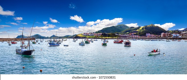 Beautiful skyline sunset  panoramic in Spain landmark.Scenery landscape of fishing port.Cityscape and boats in the sea.Cantabria village.Castrourdiales.