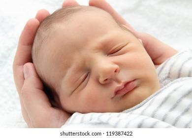 A beautiful sleeping newborn baby - close up