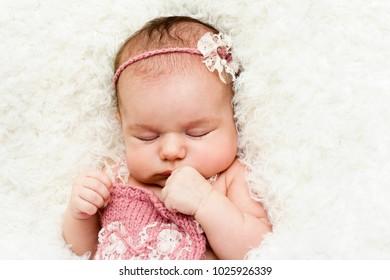 Beautiful sleeping newborn baby girl