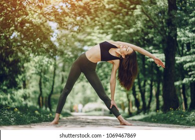 Beautiful and slender girl doing yoga in nature