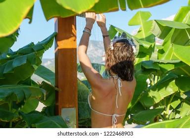 beautiful slender girl in white swimsuit on the beach