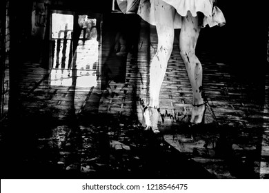 Beautiful slender women's feet in shoes  in a dark alley (black and white photo, double exposure)