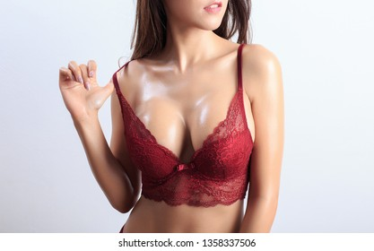 Beautiful slim body of woman in studio. Isolated on black background