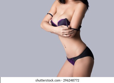 Beautiful slim body of woman in studio