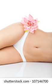 Beautiful slim female body in white panties with pink flower isolated over white background, perfect woman shape slim fit figure, sexy girl relaxing in bikini, tan skin, concept image of beauty, spa