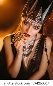 beautiful slim girl in the arms of shadow, dark queen,handmade crown, fantastic shot, toning fashionable, creative colors