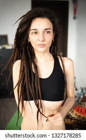 beautiful slim girl with dreadlocks in a black t-shirt