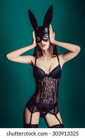 beautiful slim girl model girl in sexy lingerie masked rabbit