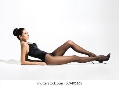 Beautiful, slim lady wearing provocative pantyhose over white background.