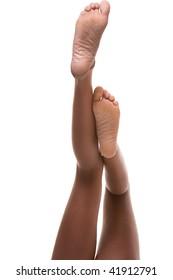 Beautiful slim legs and feet of ethnic black Afro-American female