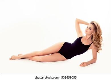 Beautiful slim sexy woman lying in black underwear.