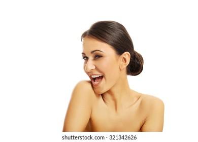 Beautiful slim spa woman laughing.