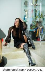 Beautiful slim striking girl in high boots