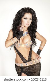 beautiful slim woman belly dancer sexy arabian turkish oriental professional artist in carnival shining costume with long healthy glossy hair. exotic star of bellydance. spring-summer