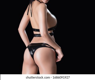 Beautiful slim woman body part. Body of women wearing sexy body suit isolated on black background.