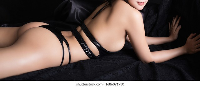 Beautiful slim woman body part. Body of sexy women wearing sexy body suit isolated on black background.