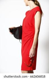 beautiful slim woman in red tight dress