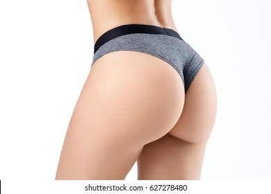 Beautiful slim woman's body. Taut elastic ass. Firm buttocks. Isolated