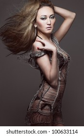 Beautiful slim young fashion model with long hair.