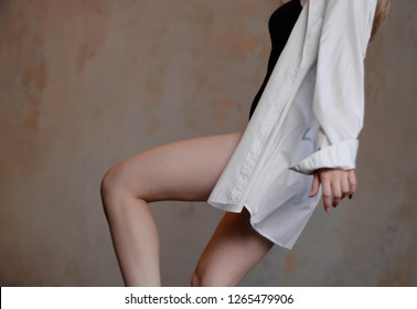 dc753ed3fd5 Beautiful slim young female modern jazz contemporary style ballet dancer  wearing a black leotard and white