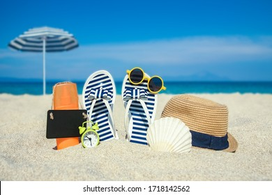 beautiful slippers in the sand of the sea in Greece background