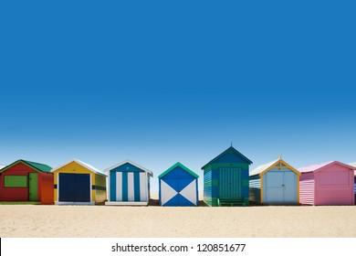 Beautiful small bathing houses on white sandy beach at Brighton Beach, Australia