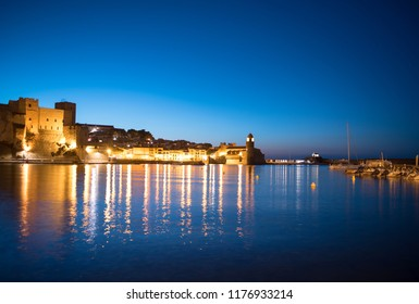 Beautiful small bay with old church of Our Lady of the Angels in the Collioure at late evening. Collioure is a coastal village in the south of France