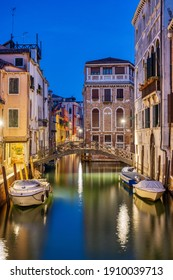 Beautiful small canal in Venice at night