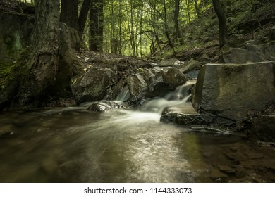 Beautiful small cascade watterfall in the summer nature