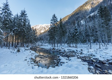 beautiful small creek in snow covered valley großarl in winter