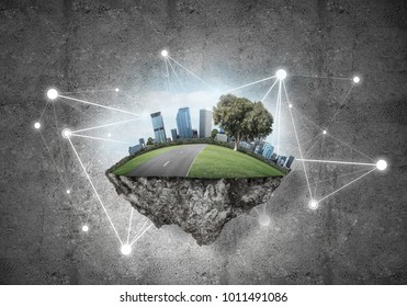Beautiful small island with grass and cityscape on concrete background