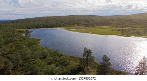 Beautiful small lake on Puljutunturi fell in Finland. In lapland you can breathe the cleanest air in the world and admire the wonderful scenery all year round.