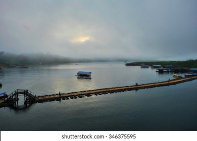 Beautiful small Mon Bridge midstream in the early morning time for fog coming.