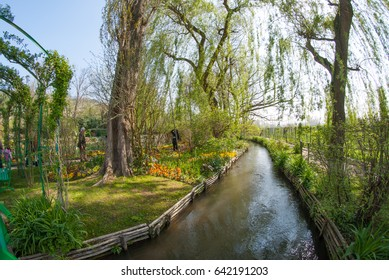 A Beautiful Small River Stream In The Claude Monet Garden Taken By Fisheye Lens. Oscar-Claude Monet Was A Founder Of French Impressionist Painting Living In Northern France In A Place Call Giverny.