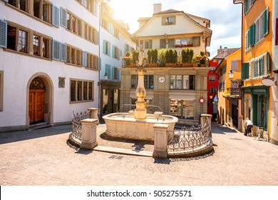 Beautiful small square with fountain in the old town of Zurich city in Switzerland
