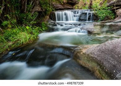 beautiful small waterfalls and plants of Sang Chan Waterfall in Ubon Ratchathani, Thailand