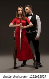 Beautiful smartly dressed couple full-length shot