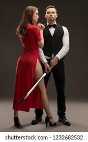 Beautiful smartly dressed woman and man shot