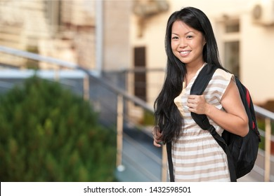 Beautiful smile asian student on campus background