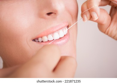 Beautiful Smile With Dental Floss
