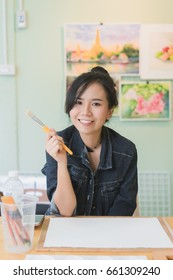 Beautiful smile girl in the painting classroom. blurred background.